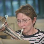 Castleton Brass Band in rehearsals. Christine Wade with her instrument.